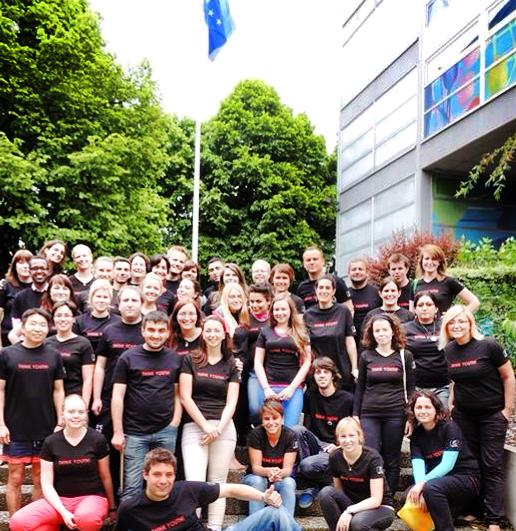 Group picture of Young people standing in front of the European Youth Center of Strasbourg